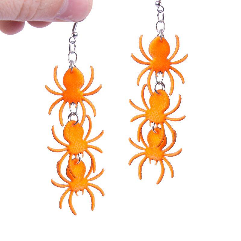 Bild på Örhängen  spindlar orange